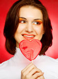Happy woman with heart candy lolly pop Royalty Free Stock Images