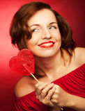 Happy woman with heart candy lolly pop Royalty Free Stock Photos