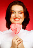 Happy woman with heart candy lolly pop Royalty Free Stock Photography