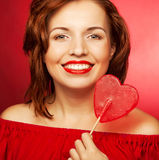 Happy woman with heart candy lolly pop Stock Photography