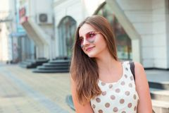 Happy woman in heart shaped sunglasses looking sideways royalty free stock photos
