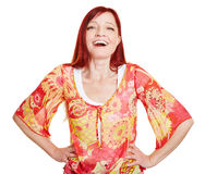 Happy woman with her arms akimbo. Happy best ager woman with her arms akimbo Royalty Free Stock Photo
