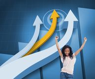 Happy woman with her arms raised up in front of arrows and statistic. Composite image of happy woman with her arms raised up in front of arrows and statistic on Royalty Free Stock Photo