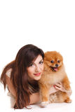 Happy woman and her beautiful little red dog spitz over white background close portrait Stock Image