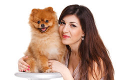 Happy woman and her beautiful little red dog spitz over white background close portrait Stock Photography