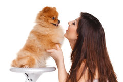 Happy woman and her beautiful little red dog spitz over white background close portrait Stock Images