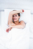 Happy woman in her bed smiling at camera Royalty Free Stock Images
