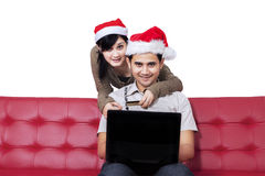 Happy woman and her boyfriend buy online Royalty Free Stock Photography
