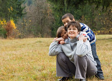 Happy woman with her children Stock Photos