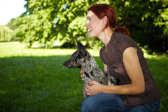 Happy woman with her dog Stock Photos