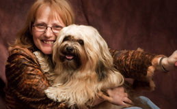 Happy woman and her dog Royalty Free Stock Photo