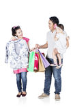 Happy woman and her family  trying clothes Stock Photography