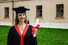 Happy woman on her graduation day. University, education and happy people - concept.  stock photos