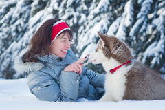 Happy woman and her Husky puppy Stock Images
