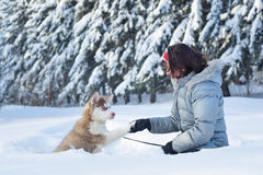 Happy woman and her Husky puppy Royalty Free Stock Photos