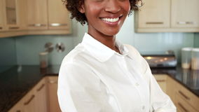 Happy woman in her kitchen stock video footage