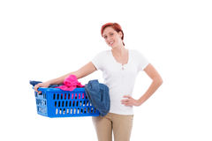 Happy woman with her laundry. Happy redhead woman with her laundry in a blue basket Royalty Free Stock Photography