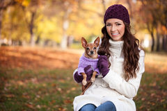 Happy woman with her little dog Royalty Free Stock Photos
