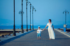 Happy woman and her little son on wooden jetty Stock Photography