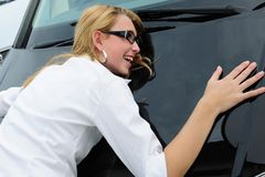 Happy woman with her new car. Woman is really happy with her new car stock image