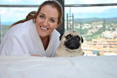 Happy woman with her pug dog royalty free stock photo