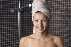 Happy woman with her wet hair in a towel Stock Photography