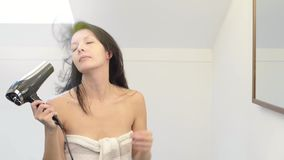 Happy woman with her wet hair in a towel stock footage