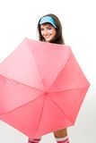 Happy woman hide behind pink umbrella Royalty Free Stock Photography