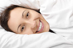 Happy woman hiding under the duvet Royalty Free Stock Photography