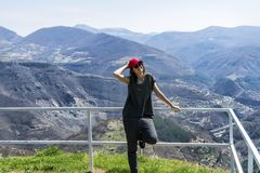 Happy Woman in a High Mountain stock photo
