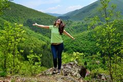 Happy Woman in a High Mountain royalty free stock photography