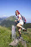 Happy woman hiker jumping over electric fence Royalty Free Stock Photography