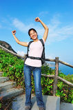 Happy woman hiker seaside Stock Photography