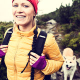 Happy woman hiking in vintage mountains with dog. Woman hiking in mountains with akita dog, vintage instagram style photography outdoors in beautiful nature Royalty Free Stock Photo