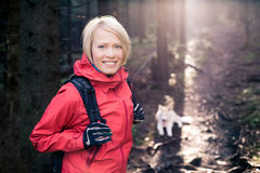 Happy woman hiking walking with dog Stock Images