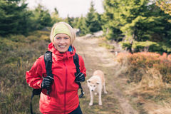Happy woman hiking walking with dog Stock Photo