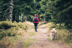 Happy woman hiking walking with dog Royalty Free Stock Image