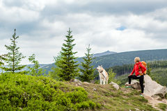 Happy woman hiking walking with dog in mountains, Poland Royalty Free Stock Images