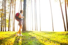 Happy woman hiking in the woods - adventure, travel, tourism, hike and people concept . stock image