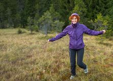 Happy woman hiker. Happy woman hiking into the woods Royalty Free Stock Photo