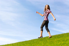 Happy woman on a hill Stock Photo