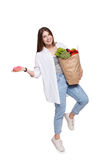 Happy woman hold bag with healthy food, grocery buyer isolated Stock Images