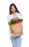 Happy woman hold bag with healthy food, grocery buyer  Stock Photos