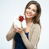 Happy woman hold gift box. White background isolated royalty free stock image