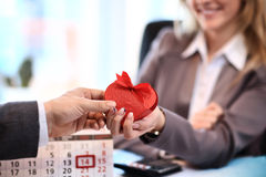 Happy woman hold Love symbol red heart. In office royalty free stock photos