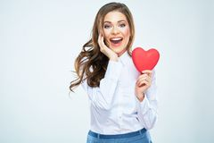 Happy woman hold red heart. Long curly hair. Beautiful female m. Odel posing on isolated white background stock photos