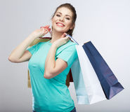 Happy woman hold shopping bag. Studio isolated portrait Royalty Free Stock Photography