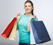 Happy woman hold shopping bag. Studio isolated portrait Stock Photo