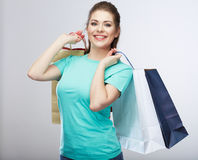 Happy woman hold shopping bag. Studio isolated portrait Stock Photos