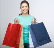 Happy woman hold shopping bag. Studio  portrait Royalty Free Stock Image